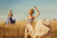 Two young beautiful girl at field Royalty Free Stock Photography