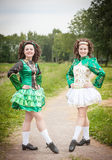 Two young beautiful girl in irish dance dress posing outdoor Royalty Free Stock Photo