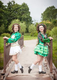 Two young beautiful girl in irish dance dress posing outdoor Stock Image