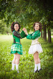Two young beautiful girl in irish dance dress posing outdoor Stock Photo