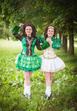 Two young beautiful girl in irish dance dress posing outdoor Royalty Free Stock Images