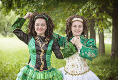 Two young beautiful girl in irish dance dress posing outdoor Royalty Free Stock Photography