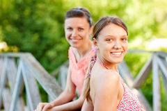 Two young and beautiful girls at banisters Stock Photography