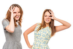 Two young beautiful girls with funny grimace Royalty Free Stock Image