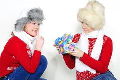 Two young beautiful girls with gifts. On a white background Stock Photo
