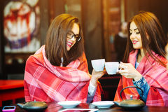 Two young and beautiful girls gossiping Royalty Free Stock Photo