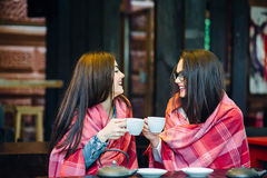 Two young and beautiful girls gossiping Stock Photo