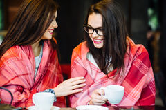 Two young and beautiful girls gossiping Stock Images