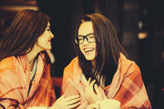 Two young and beautiful girls gossiping Royalty Free Stock Photography