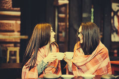 Two young and beautiful girls gossiping Stock Photos