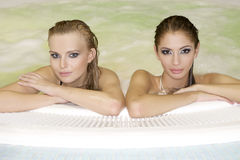 Two young beautiful girls in jacuzzi Royalty Free Stock Images