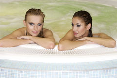 Two young beautiful girls in jacuzzi Royalty Free Stock Photography
