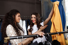 Two young beautiful girls making shopping in mall. Two young beautiful girls in dresses making shopping, smiling in mall Stock Photos