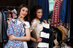 Two young beautiful girls making shopping in mall. Two young beautiful girls in dresses making shopping, smiling in mall Stock Image