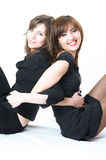 Two young beautiful girls over white background Royalty Free Stock Images