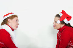 Two young beautiful girls play a white background Royalty Free Stock Photos