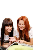 Two young and beautiful girls in room Stock Photography