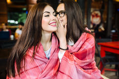 Two young and beautiful girls share secrets Royalty Free Stock Photography