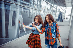 Two young beautiful girls are studying and looking at the map.Ar Stock Photo