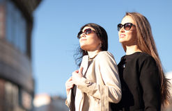Two young beautiful girls walking the streets of the city. Stock Photo