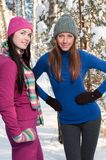 Two young beautiful girls in winter Royalty Free Stock Images