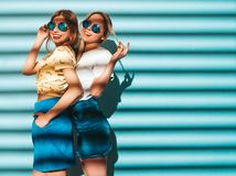 Two Young Beautiful Hipster Girls In Trendy Clothes In Studio Royalty Free Stock Images