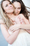 Two young beautiful hugging girls Stock Photo