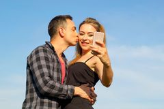 Two Young beautiful man and woman in casual clothes making selfi Stock Photography