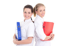 Two young beautiful nurses with folders Stock Photography