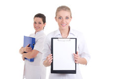 Two young beautiful nurses with folders. copyspace Royalty Free Stock Image