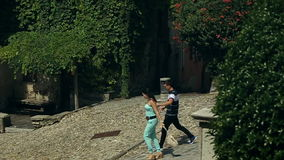 Two Young and Beautiful People Boy and Girl are Holding Hands. Italy August 2015 in Arona city stock footage