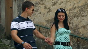 Two Young and Beautiful People Boy and Girl are Holding Hands. Italy, August 2015 in Arona. City HD Slow motion stock video footage