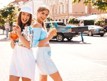 Two Young Beautiful Smiling Hipster Girls In Trendy Summer Clothes Royalty Free Stock Photos