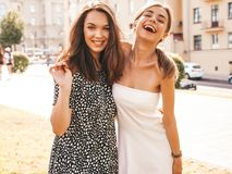 Two Young Beautiful Smiling Hipster Girls In Trendy Summer Clothes Royalty Free Stock Image