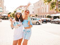 Two Young Beautiful Smiling Hipster Girls In Trendy Summer Clothes Royalty Free Stock Photo