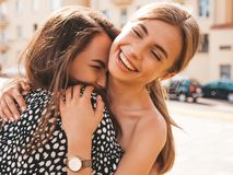 Two Young Beautiful Smiling Hipster Girls In Trendy Summer Clothes Stock Photo