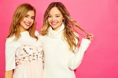 Two young stylish woman models in summer hipster clothes stock photo