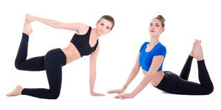 Two young beautiful sporty women doing stretching exercises isol. Ated on white background Royalty Free Stock Image