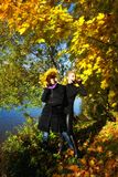 Two young beautiful woman. In autumn park by the river Royalty Free Stock Image