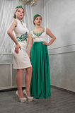 Two young, beautiful woman, brunette, blonde in white short dres Royalty Free Stock Photo