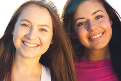 Two young beautiful woman on the sky background Stock Photography