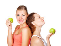 Two young beautiful women with an apples Stock Photo