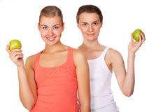 Two young beautiful women with an apples Royalty Free Stock Photos