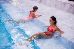 Two young beautiful women in jacuzzi of resort royalty free stock photo