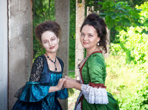 Two young beautiful women in long medieval dresses Stock Photography