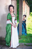 Two young beautiful women in long medieval dresses Royalty Free Stock Image