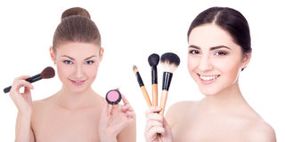 Two young beautiful women with make up brushes and rouge or powder isolated on white. Background stock photography