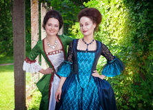 Two young beautiful women in medieval dresses outdoor Royalty Free Stock Photo
