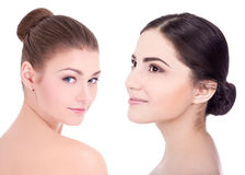 Two young beautiful women with perfect skin  on white Royalty Free Stock Image