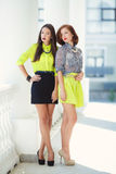 Two young beautiful women on the street in the city. Royalty Free Stock Images